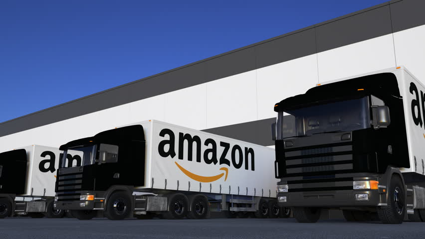 Freight semi trucks with Amazon.com logo loading or unloading at warehouse dock, seamless loop. Editorial 4K animation