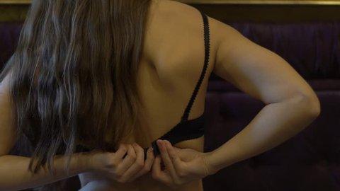 Woman Dressing 1 - Bare Shoulder. Bra