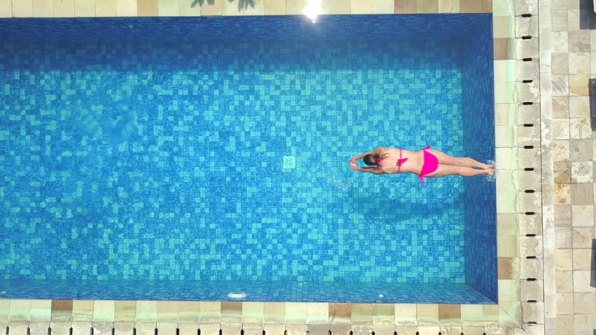 Rectangle Pool Aerial View drowning girl, woman in a swimming pool, 4k aerial shot stock
