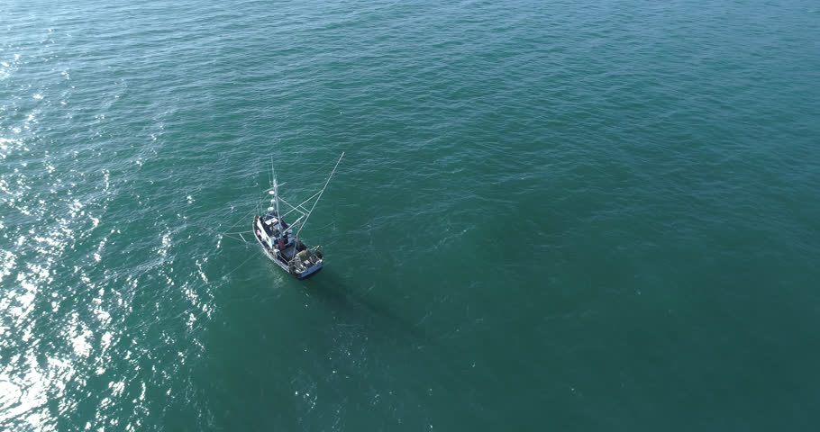 High Aerial 4k source anchored fishing boat aqua blue water California coastline Late afternoon- h265 converted to prores444 Phantom 4 pro - color grades better than other Phantom footage 3 in the set | Shutterstock HD Video #29304802