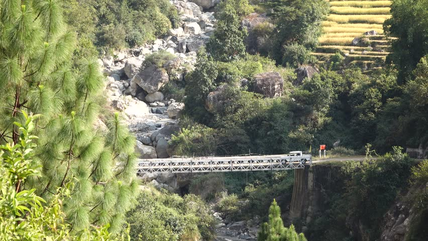 MONGAR, BHUTAN - MARCH 2016: Nature views with waterfall, pine forest  in Mongar, Bhutan.