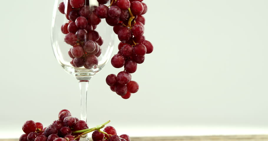 Close-up of red grapes in glass against white backgroyund | Shutterstock HD Video #29330422