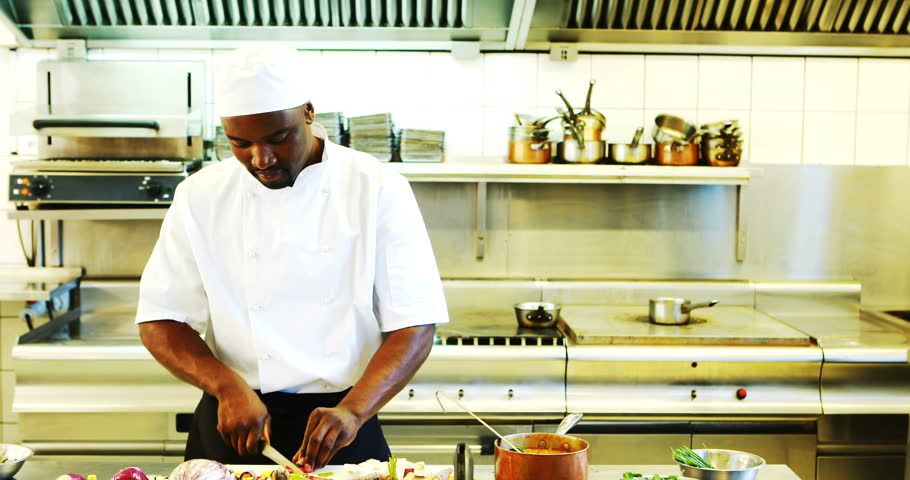 Chef preparing food in commercial kitchen at resturant