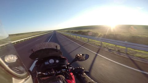 motorcyclist driving on road