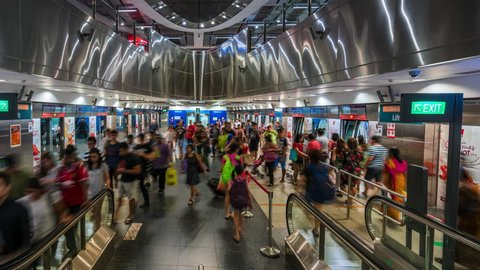 Singapore, Singapore - December 18, 2016: Singapore Timelapse view showing view of Harbourfront MRT station busy with passengers and commuters by day