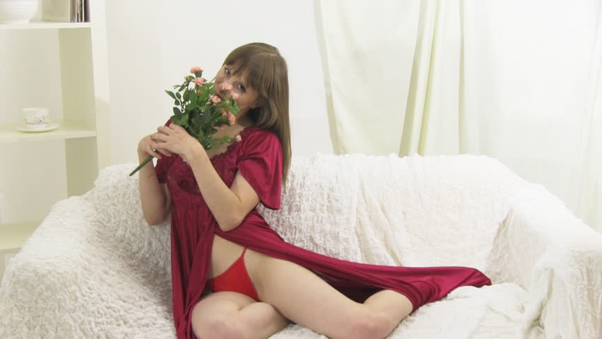 beauty girl in red dress on the sofa
