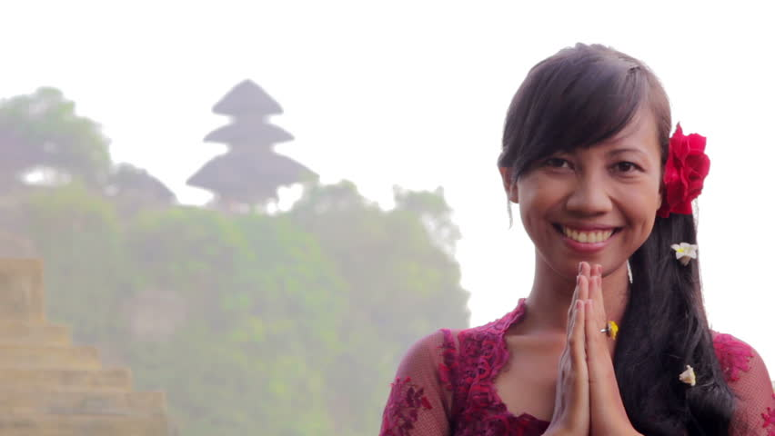 Balinese girl saluting with both hands