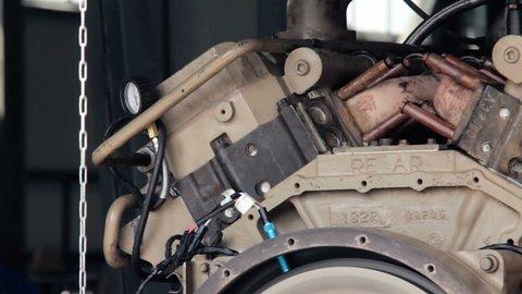 engine starting. Test start of a diesel engine. Trial run of a diesel engine. flywheel turns. flywheel begins turns