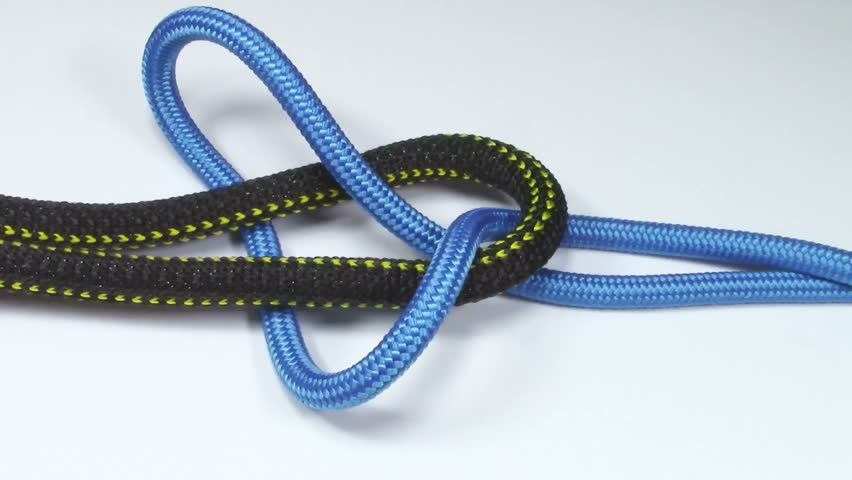 Reef knot made from two different synthetic ropes , tied on white background #29461798