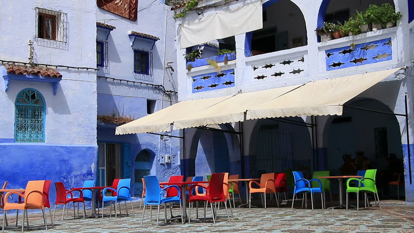 Nice view of square with traditional cafe, coffee-house in beautiful old blue town Chefchaouen Chaouen / Morocco