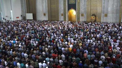 SURABAYA, INDONESIA - APRIL, 2017: Muslim men attend Friday prayer in crowded mosque in Surabaya