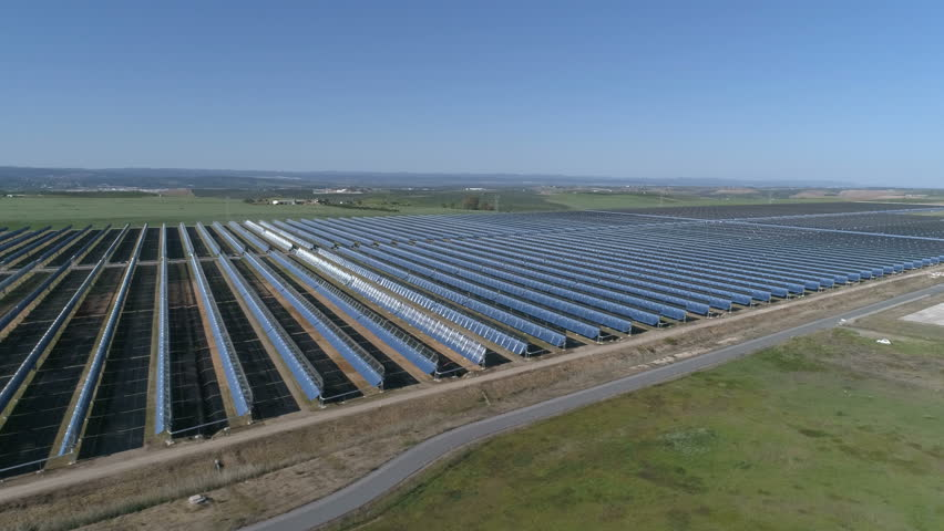 aerial shot of a thermosolar plant of generation of renewable energy 4k stock video clip