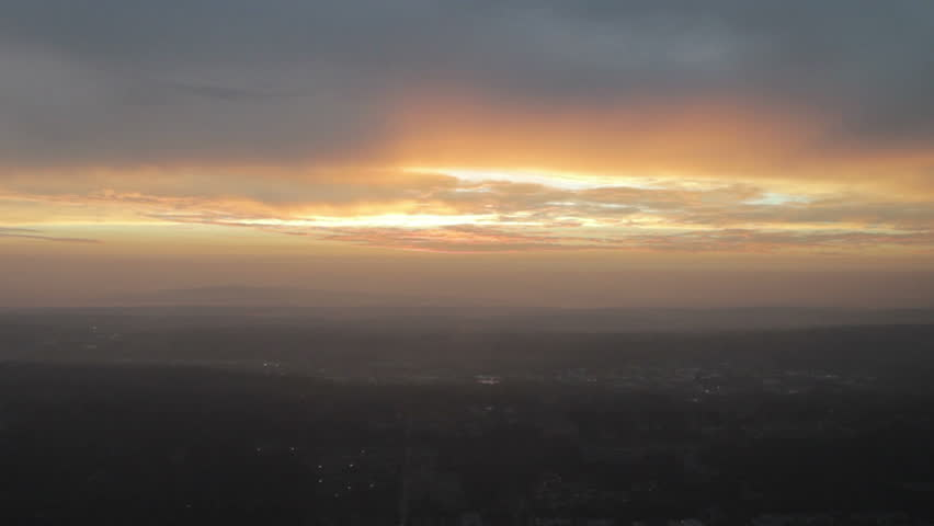Bright sunrise over mountainous area - aerial view