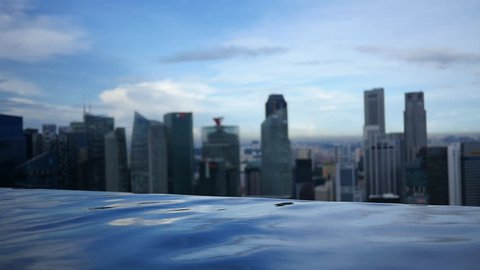 Infinity Pool Overlooks City Skyline - The edge of an infinity pool creates a line of water above which there is a great view of a city skyline