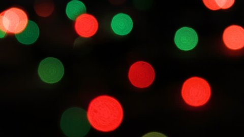 Flashing colored lights in a blur. The bokeh effect. Electric Christmas tree lights. Footage clip 4k