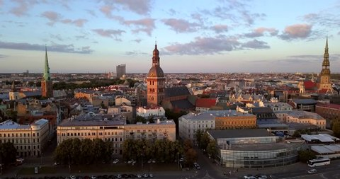 Beautiful Riga old town aerial view from above. Flying past Dome Cathedral.