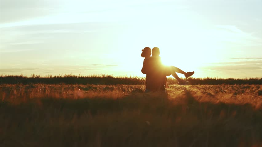 Girl and a man in love in the field #29595442