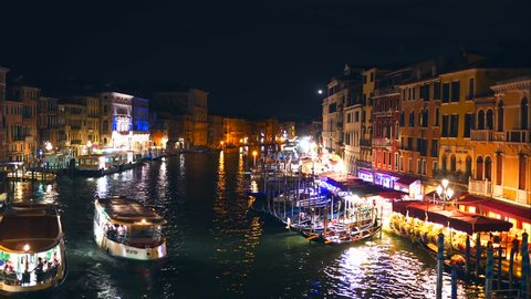 Venice, Italy, Rialto Bridge on the Canale Grande, night footage, Venice at night, gondola passing by Timelapse