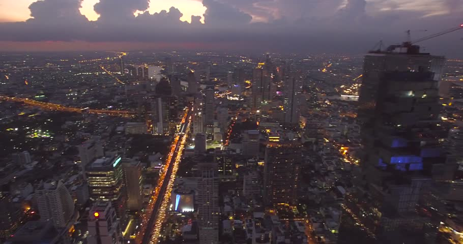 Dusk and City Lights in Sathorn District, Central Bangkok, Thailand, Aerial Shot with Pan | Shutterstock HD Video #29643172