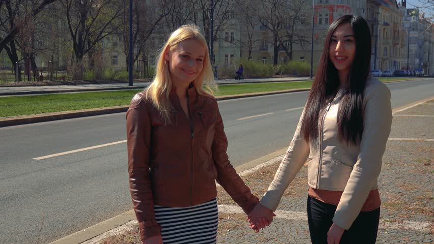 Two Lesbians Holding Hands Stock Footage Video  Shutterstock-3651