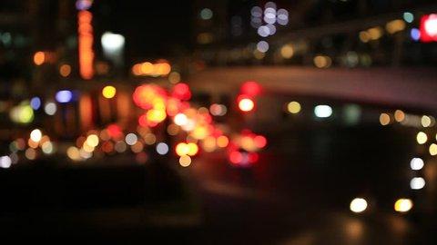 City view at blurred bokeh of car and night traffic lights Bangkok