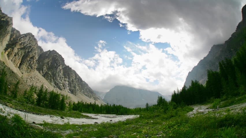 Timelapse landscape with white clouds and high mountain