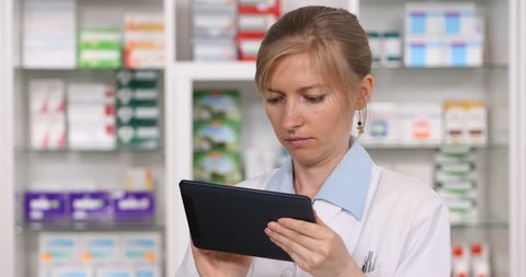 Close up Of Confident Medical Woman Using Digital Tablet, Drugs Inventory Pharmacy