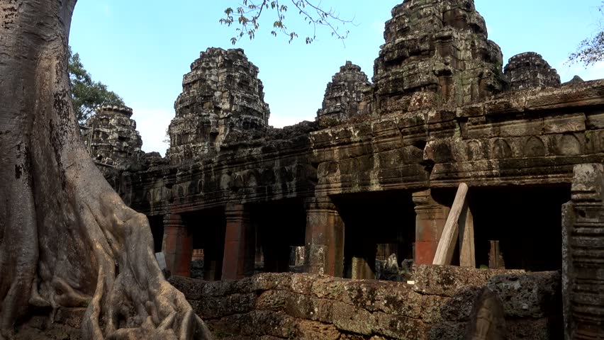 Panning shot of Banteay Kdei temple starting on a huge tree and its massive roots. #29738722