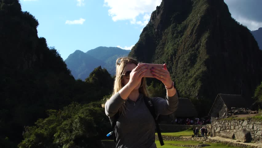 Woman taking selfie photos in Machu Picchu, Peru