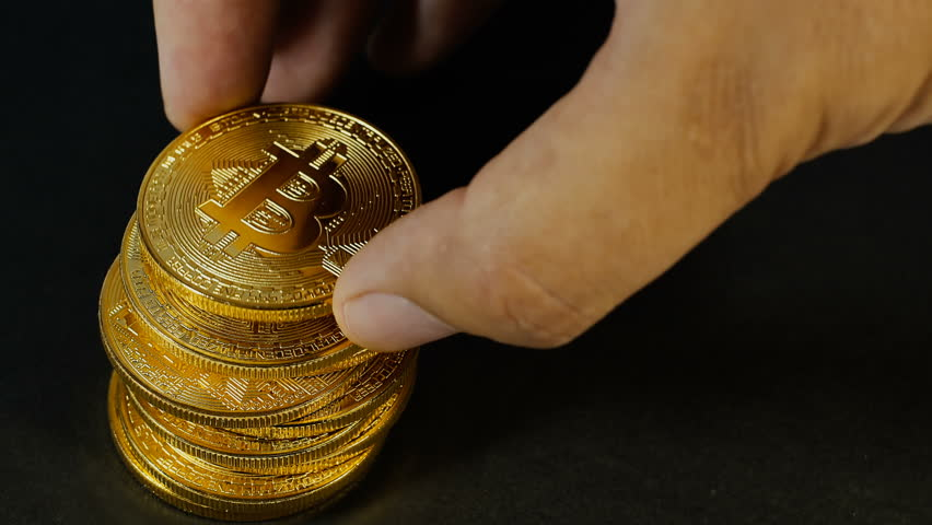 The Mans Hand Puts Bitcoins In A Column Counting Gold Crypto