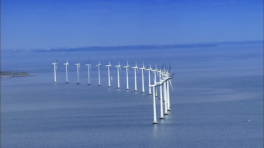 Aerial view of wind turbines at sea