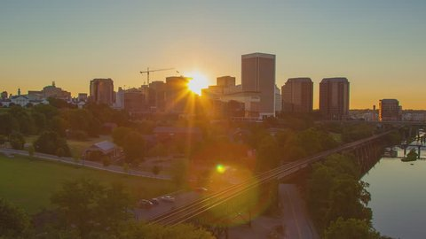 Richmond VA City Skyline Daybreak Timelapse at Dawn with the Sun Rising from Behind the Virginia Capital City Buildings