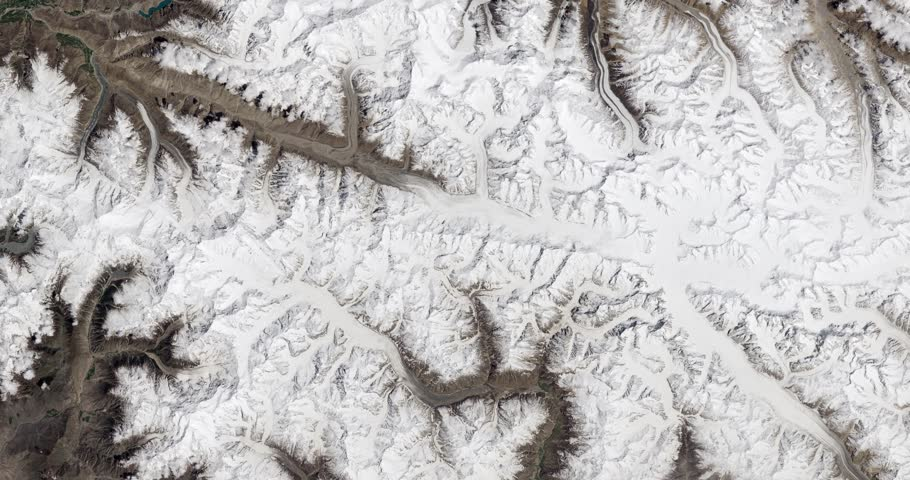 Very high-altitude overflight aerial of the Karakoram Mountains of northern Pakistan. Clip loops and is reversible. Elements of this image furnished by NASA