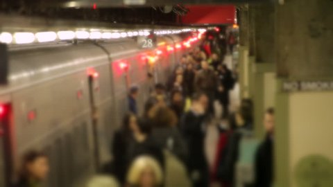 NEW YORK - CIRCA, November 2012: Crowd of anonymous commuters getting off train at Grand Central station Slow Motion