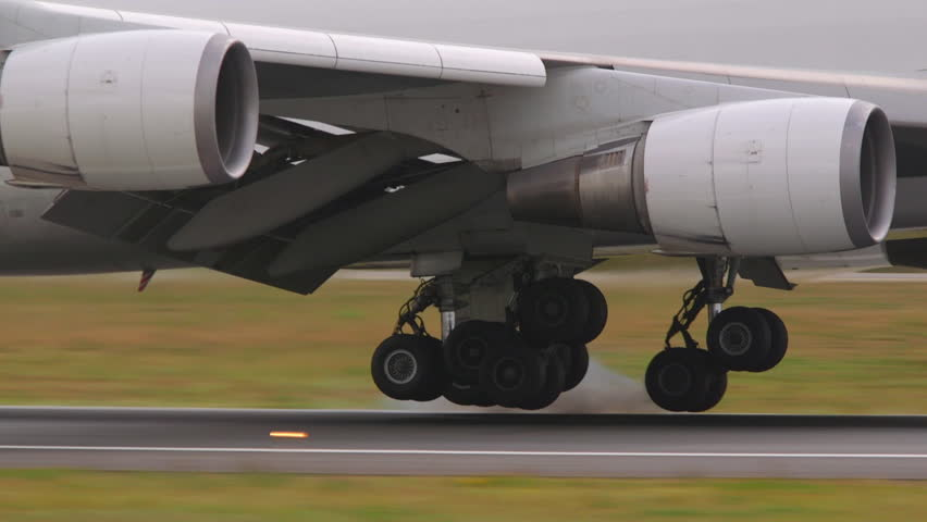 airplane jumbo jet 747 wheels touchdown runway slow motion