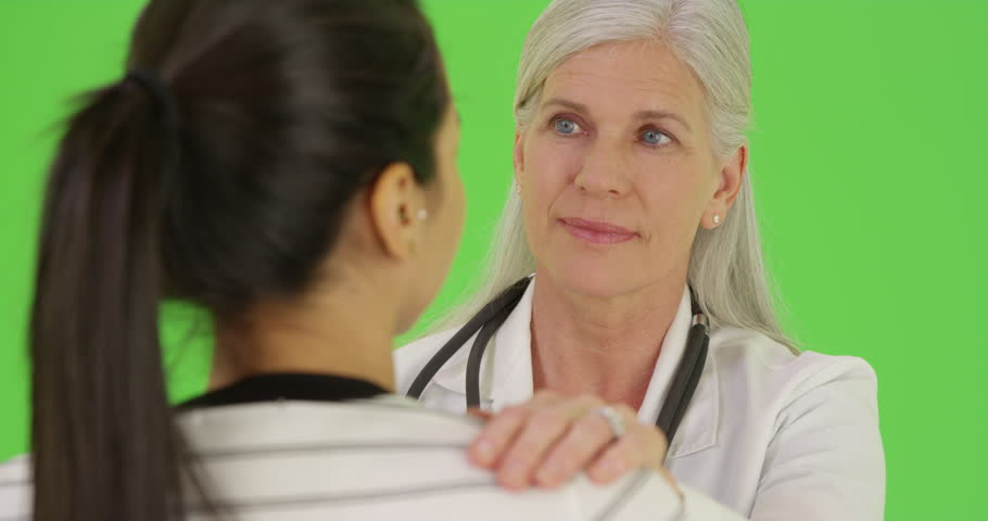 A smiling doctor talks to one of her patients on green screen. On green screen to be keyed or composited. on green screen. On green screen to be keyed or composited.