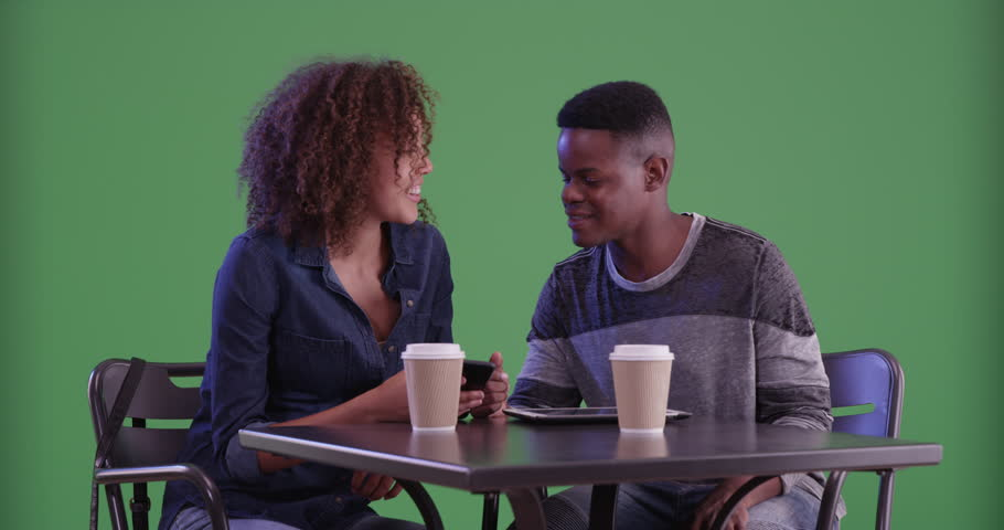 Young African American couple have coffee on green screen. On green screen to be keyed or composited. | Shutterstock HD Video #29820922