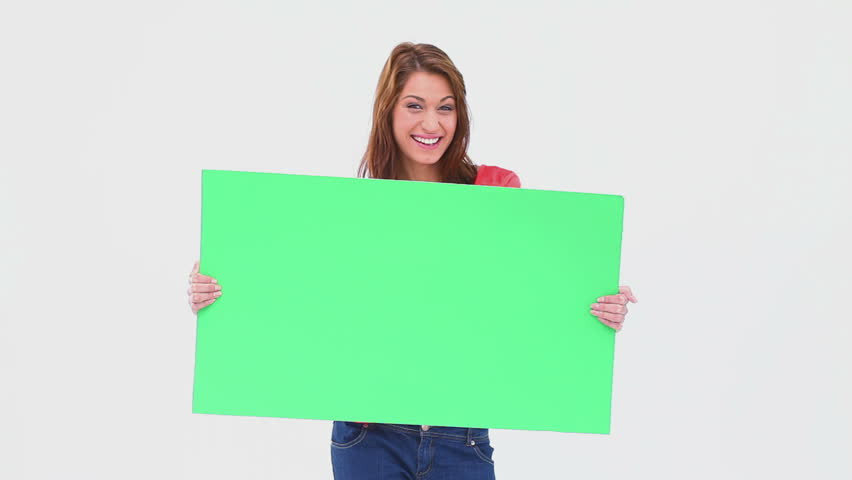 Brunette haired woman holding a blank poster against white background