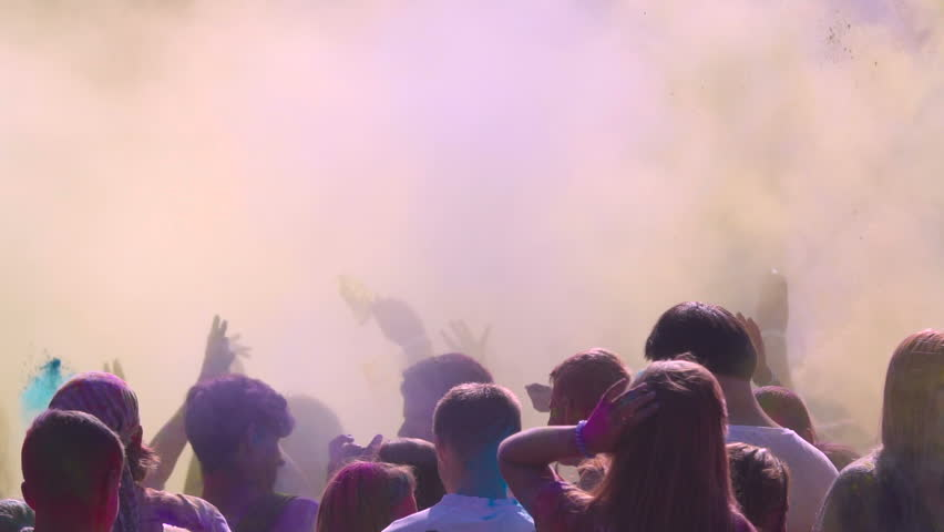 Holi Color Festival. Crowd of people raise their hands up and throw out colorful powder. Slow motion | Shutterstock HD Video #29859283