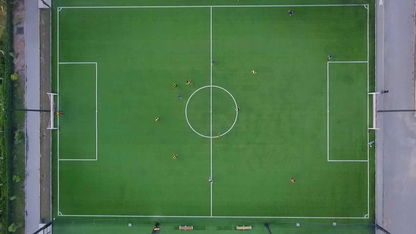 aerial view of football team practicing at day on soccer field in top view | Shutterstock HD Video #29881426