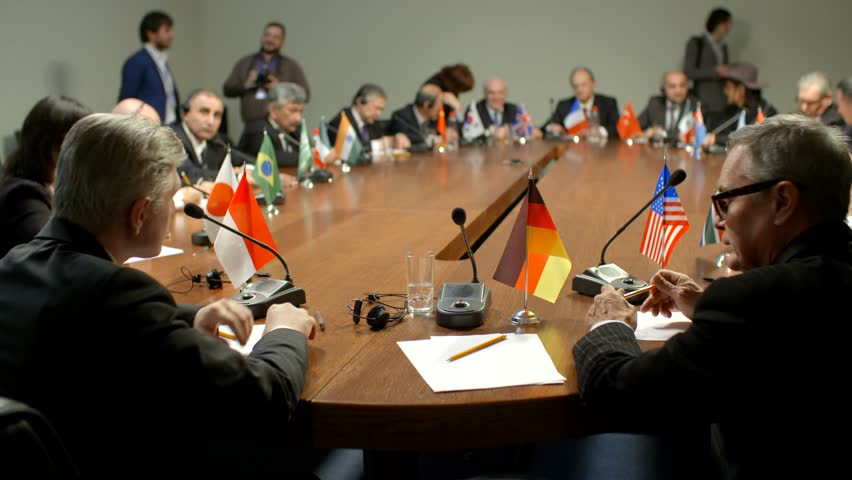 Shot of German flag. The international Commission at the round table. Participants of group of G20 applaud the representative of Germany | Shutterstock HD Video #29883712