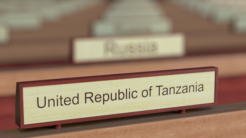 United Republic of Tanzania name sign among different countries plaques at international organization. 3D rendering