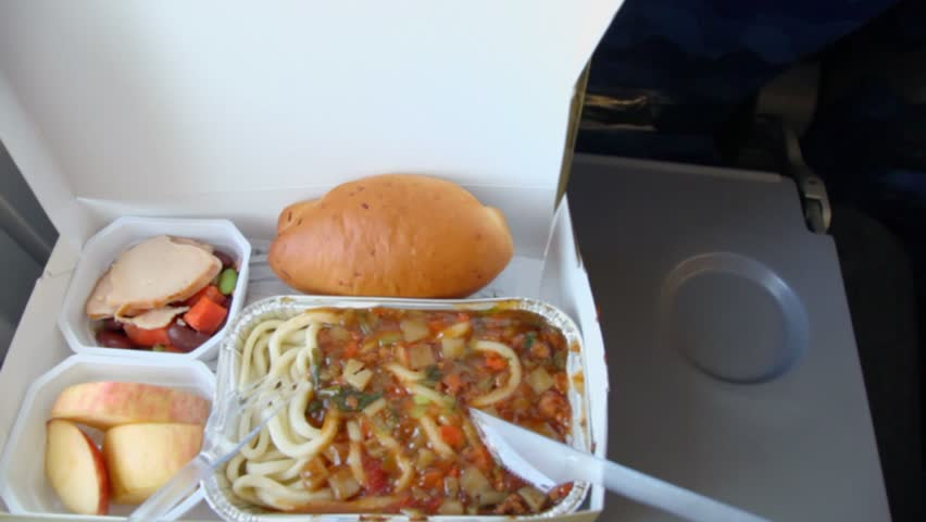 Meal for passenger in aircraft, closeup view in motion