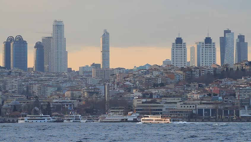 Istanbul city skyline at sunset, showing the buildings rising above Besiktas