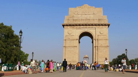 NEW DELHI, INDIA - MARCH, 2017: tourists visit to India Gate on March, 2017. India Gate was built to memorialize the Indian soldiers who lost their lives during the First World War. Time lapse.