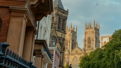 Telephoto shot of the Gothic York Minster in Yorkshire, England, UK bathed by golden hour sunlight