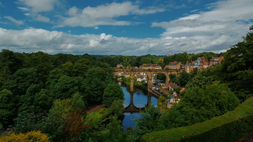 Postcard wide establishing shot of the medieval town of Knaresborough, Yorkshire, England, UK, the railway viaduct and river Nidd