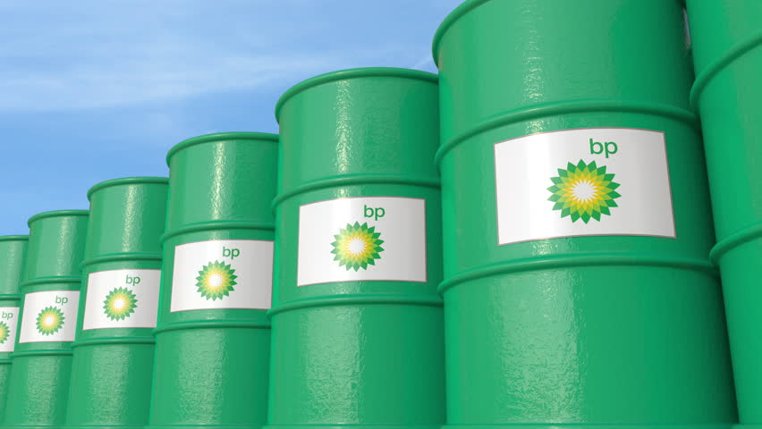 Row of metal barrels with BP P.L.C. logo against sky, seamless loop. 4K editorial animation