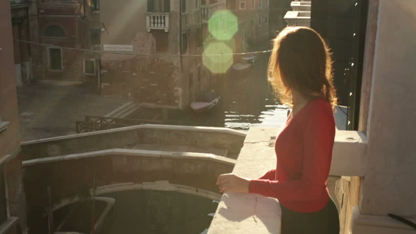Young girl on a balcony in Venice - HD stock footage clip