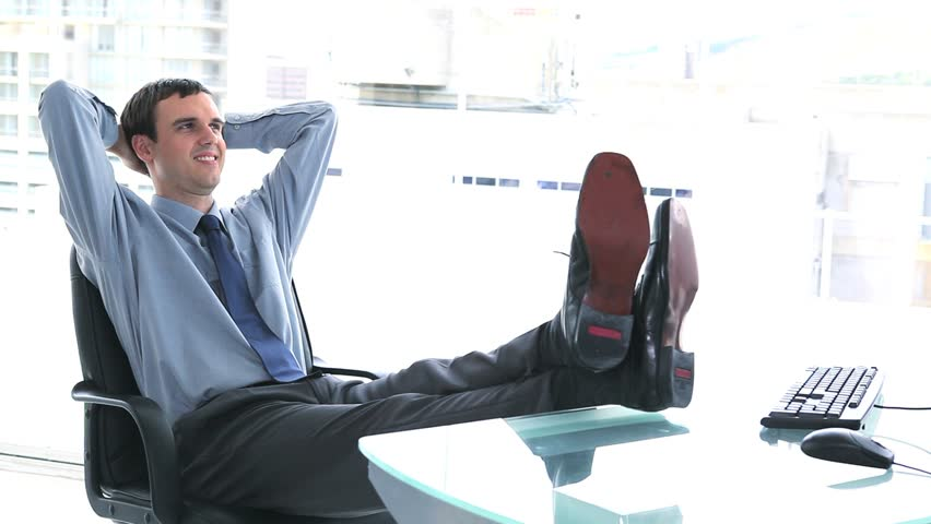 Young Businessman Resting In His Office With Feet On The Desk Hd Stock Video